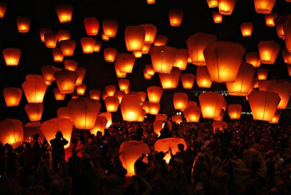 People release sky lanterns to celebrate the traditional Chinese Sky Lantern Festival in Pingsi, Taipei.